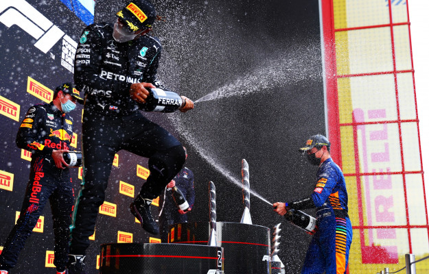 In Imola the first toast of Ferrari Trento on the F1 podium, with Versappen, Hamilton and Norris